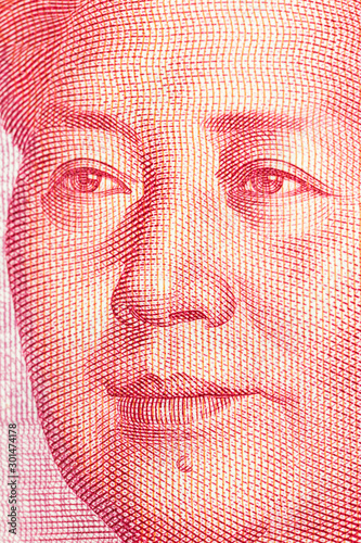 Vertical macro close up photograph of Mao on the Chinese 100 Yuan currency note.   #301474178