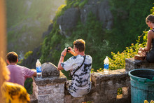 Tourists Watch The Sun Go Down At The Top Of Mua Caves During A Beautiful Sunset In Northern Vietnam