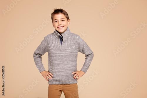 Fashionable happy teen boy posing.