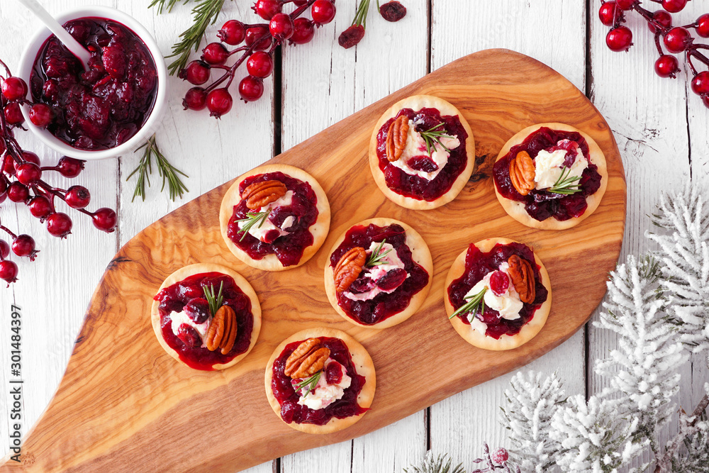 Fototapety, obrazy: Platter of holiday appetizers with cranberries, goat cheese and pecans. Top view serving scene on a white wood background