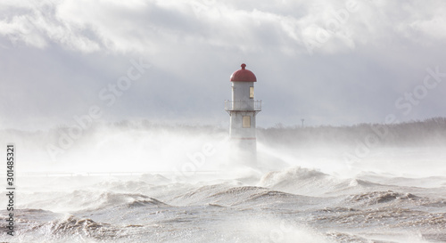 Obraz Lachine lighthouse being battered by a storm in early November, Quebec, Canada. - fototapety do salonu