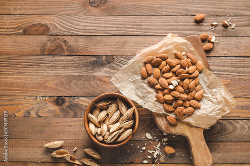 Tasty almonds on wooden background