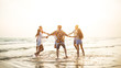 canvas print picture - A group of friends who party and play fun on the beach.
