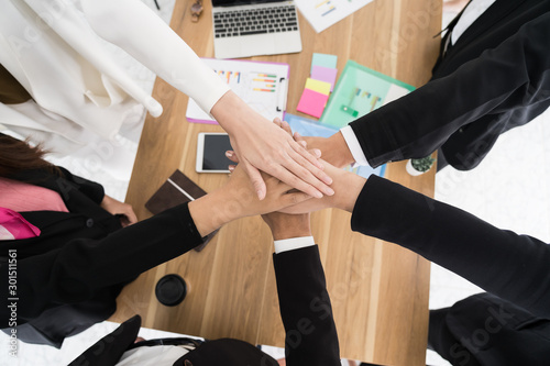 group business people hands were collaboration to trust in business success concept of teamwork partnership in company