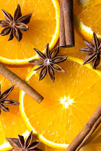 Slices Of Bright Color Oranges. Texture Background Ripe Juicy Fruits Oranges. Product Image Tropical Oranges Fruit. Bright Orange Background From Slices Of Juicy Oranges With Anise Stars, Cinnamon