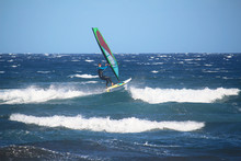 Windsurfer Jumping Over The Waves Of The Atlantic Ocean (El Medano, Spain)