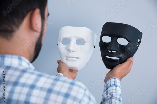 man hand white and black mask Canvas Print