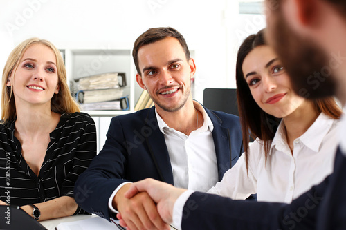 Fototapety, obrazy: Smiling man in suit shake hands as hello in office