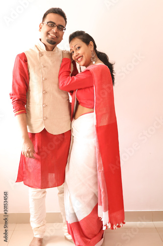 Obraz na plátně a young indian bengali assamese married romantic couple dressed in red and white