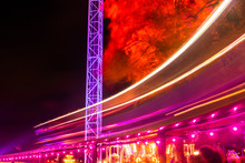 Helsinki, Finland - 19 October 2019: The Carnival Of Light Event At The Linnanmaki Amusement Park. Ride Train Maisemajuna In Motion. Night Illumination, Long Exposure.