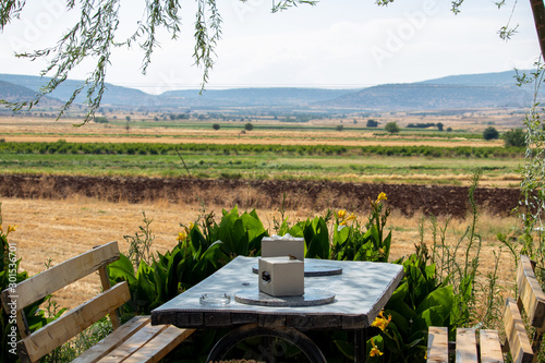 Foto auf Leinwand Schokobraun garden table restaurant with beautiful landscape