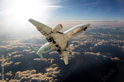 Obraz samolot  passenger-plane-flies-high-above-the-clouds