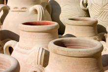 Traditional Tunisian Earthenware Pots. Unglazed And Unpainted Pottery Drying Naturally In The Warmth Of The North Africa Sun.