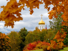Golden Dome With A Cross Of The Orthodox Church In A Bright Autumn Landscape