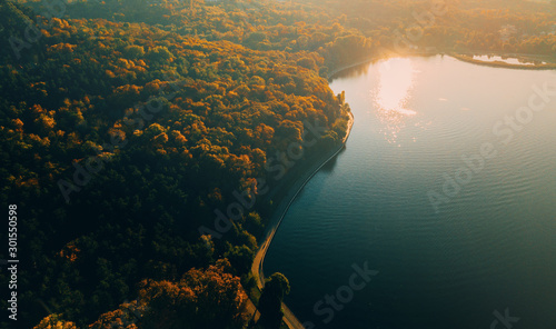 Aerial drone shot of beautiful landscape with lake in park, cityscape, blurry im Canvas Print