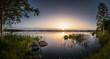 Leinwandbild Motiv Calm and relax scenery at twilight sunset over big swamp lake in Estonia