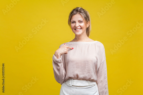 This is me! Portrait of proud happy woman with fair hair in casual beige blouse standing, pointing at herself, boasting personal achievement at camera Canvas Print