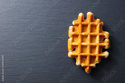 Fotografía  Belgian waffle. Slate background. Copy space. Top view.