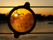 The Sun Sets Through A Hole Ma...