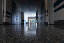 Light At The End Of The Corridor With Gurney In The Hospital