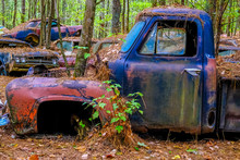 Blue Truck With Red Fender In A Junkyard