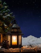 Glowing Lantern Under Starry Sky