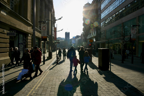 Silhouette of figures in St Ann's Square Manchester Wallpaper Mural