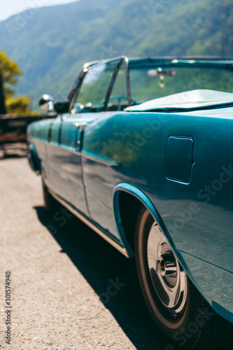 Photo sur Aluminium Vintage voitures Color detail a vintage car sky blue color and shiny chrome, selective focus, turquoise, vertical photo