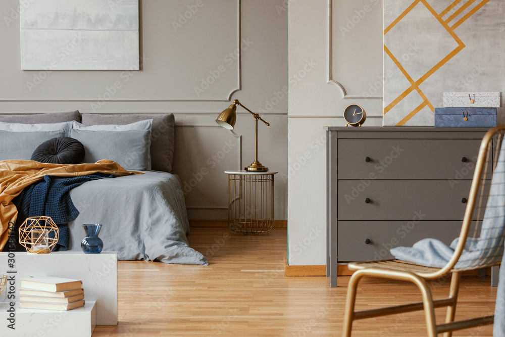 Fototapety, obrazy: Trendy bedroom interior with grey commode and golden chair