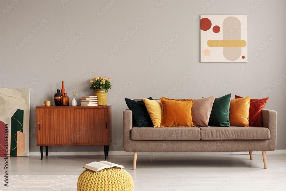 Fototapeta Retro style in beautiful living room interior with grey empty wall