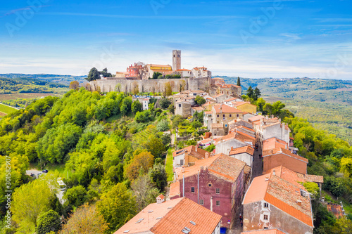 Staande foto Oude gebouw Old town of Motovun on the hill, beautiful architecture in Istria, Croatia, aerial view from drone