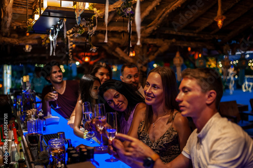 Group Of Friends Enjoying Drink At Outdoor Bar