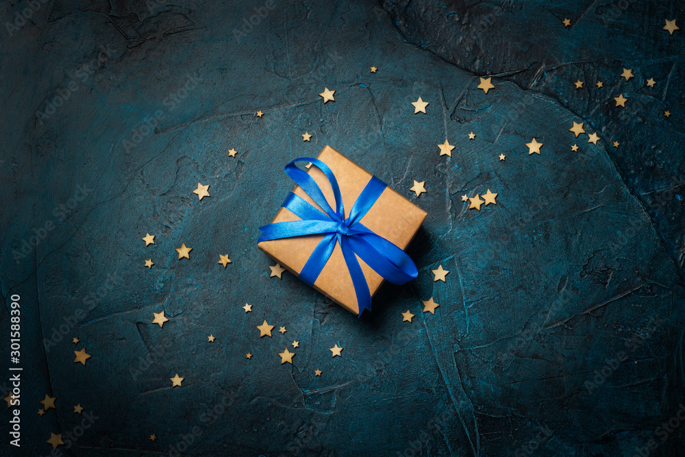 Fototapety, obrazy: Gift box on a dark blue stone background with stars. Gift concept for a loved one, night. Flat lay, top view