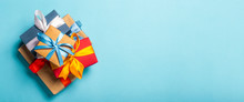 Stack Of Gifts On A Blue Background. Gift Concept For A Loved One, Holiday, Christmas. Banner. Flat Lay, Top View