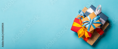 Stack of gifts on a blue background Wallpaper Mural
