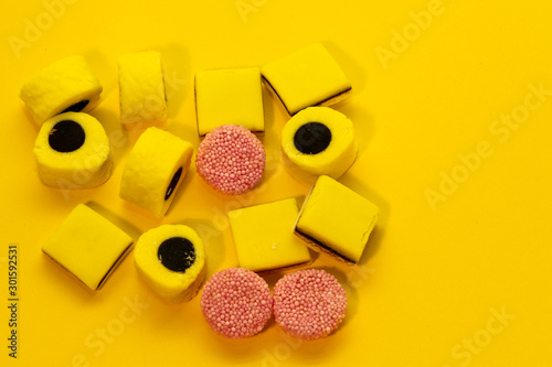 Licorice Allsorts againts a yellow background Wallpaper Mural