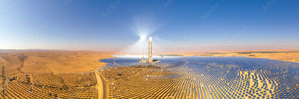 Fototapeta Solar power tower and mirrors that focus the sun's rays upon a collector tower to produce renewable, pollution-free energy, Aerial