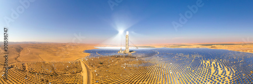 Fototapeta Solar power tower and mirrors that focus the sun's rays upon a collector tower to produce renewable, pollution-free energy, Aerial obraz