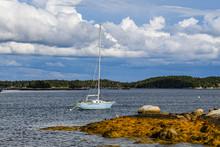 Weathered Sailboat Anchored In A Nova Scotia Bay