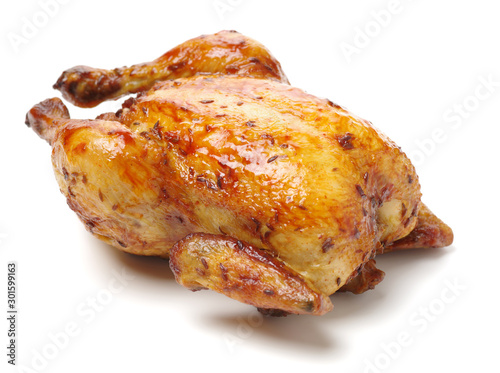 Fotografia Whole roasted chicken against white background