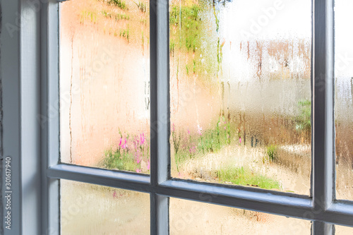 Obraz Condensation on an old window of a home - fototapety do salonu