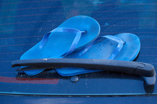 Blue Flip Flop On Rear Wiper. Vacation Concept.