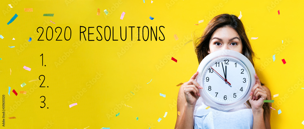 Fototapety, obrazy: 2020 Resolutions with young woman holding a clock showing nearly 12