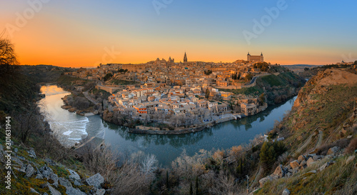 Fascinating panoramic view of sunset over the old town of Toledo and river Tajo. Travel destination Spain