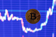 canvas print picture - bitcoin shiner flying over blurry dark blue exchange graphic chart