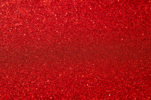 Festive Abstract Red Glitter Texture Background. Colorful Background With Glittering And Sparkling Spots. Suitable For Christmas, New Year, Chinese New Year And Designs. Selective Focus