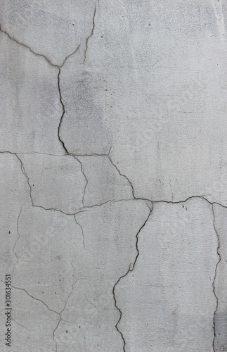 Valokuvatapetti Texture of painted plasterwork with multiple cracks
