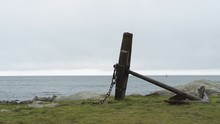 A Static Shot Of A Big Anchor Lying Next To The Ocean On The West Coast Of Sweden, Outside Of Varberg.