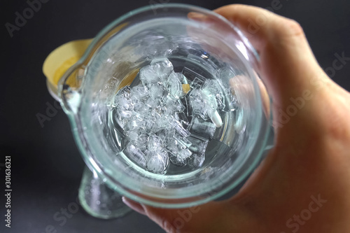 Ice in a glass, look in glass with ice. Wallpaper Mural