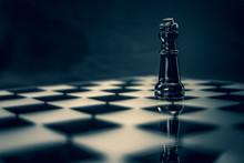 Black Glass King Chess Piece On Glass Chess Board